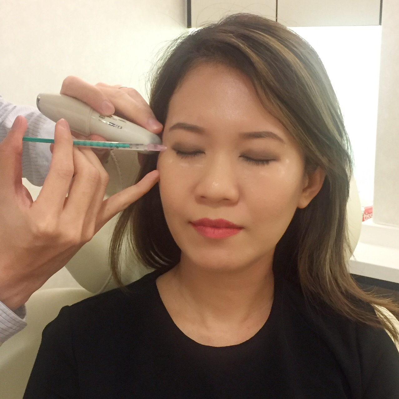 Dr Ee administering the Botox injections